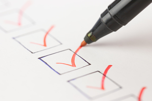 marker checking off boxes on checklist